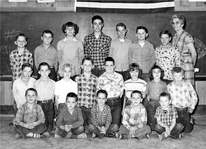 Erick Conard (first row, middle) and Frank Conard II (second row,second from left) at Buckeye School in Lycan, Colorado in 1955.