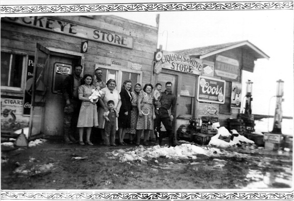 Iva Hazel Henry Conard Delaney Doyle standing in front of Buckeye Store with family