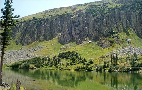 Goose Lake with boat and cliffs in distance